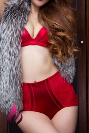 Rebeca wearing red underwear and a fur jacket