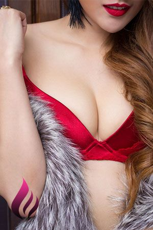 Rebeca smiling in red lingerie and a fur coat